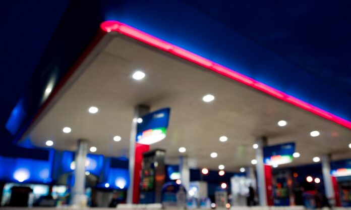 Blurry Image Of Gas Station At Night